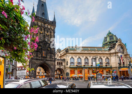 The Powder Tower separating Old Town from New Town in Prague, Czechia, with lights coming on inside the Municipal House as the sun goes down in Prague - Stock Photo