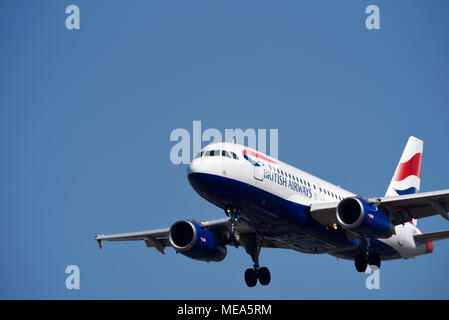 British Airways Airbus A319 jet plane airliner coming in to land at London Heathrow Airport, UK, in blue sky. A319-131 G-EUPY. Large space for copy - Stock Photo