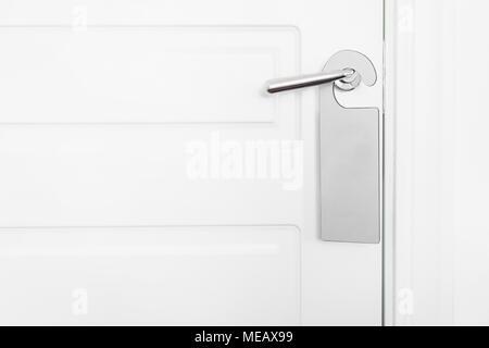 Door knob with empty label on a door handle for your text. Empty white flyer mockup hang on door handle. Leaflet design on entrance doorknob. Dont disturb sign. Hotel room clear hanger. blank - Stock Photo