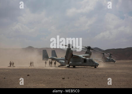 180402-M-IZ659-0027 DJIBOUTI, Djibouti (April 2, 2018) U.S. Marines assigned to Battalion Landing Team, 2nd Battalion, 6th Marine Regiment (BLT 2/6), 26th Marine Expeditionary Unit (MEU), disembark an MV-22B Osprey medium tilt-rotor aircraft, April 2, 2018. The 26th MEU trains to sustain expeditionary readiness across a range of critical capabilities both afloat and ashore in order to be prepared to respond to crisis in the U.S. 5th Fleet Area of Operations. (U.S. Marine Corps photo by Cpl. Santino D. Martinez/Released)