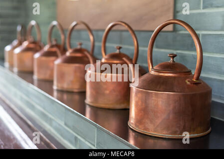 Copper teapots in a row in Chengdu, China - Stock Photo
