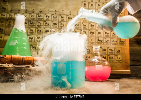 Academic chemical lab with color beakers in school - Stock Photo