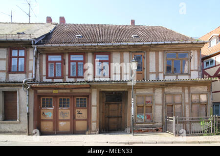 Salzwedel, Germany - April 21, 2018: View of a dilapidated half-timbered house in the Hanseatic city of Salzwedel, Germany. - Stock Photo