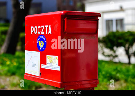 Bialystok, Poland - April 30, 2012: Red metal mailbox of national and international state Polish postal service. Letter box on main street of Bialysto - Stock Photo