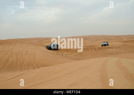 Desert safari of Dubai is famous attraction for the tourist. It is fun with bumpy and scary ride. - Stock Photo