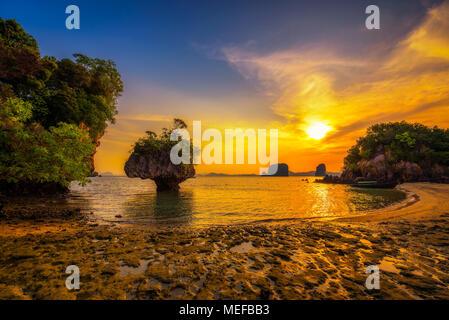 Sunset over Laopilae archipelago around Ko Hong island near Krabi, Thailand - Stock Photo