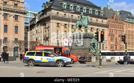 Fire trucks, police and rescue vehicles on Gustav Adolfs torg (square) in spring - Stock Photo