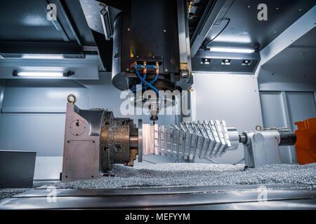 Metalworking CNC milling machine. Cutting metal modern processing technology. Small depth of field. Warning - authentic shooting in challenging condit