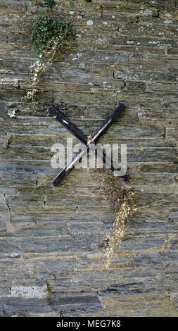 Black cross shaped anchor plate. - Stock Photo