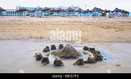 Sandcastle and mote with the Playa de Cabanyal in the background, Valencia Spain - Stock Photo