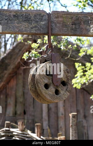 An ancient block and tackle weathering in the sun at the Weald and Downland museum in Chichester, UK - Stock Photo