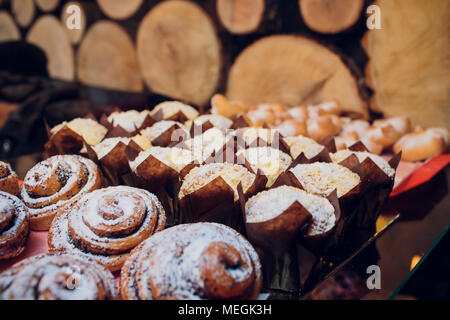 Table full of assorted confectionery sweets and desserts - Stock Photo