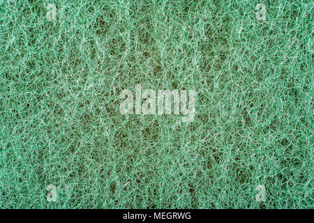 Green texture abrasive sponge close up scrub face. - Stock Photo