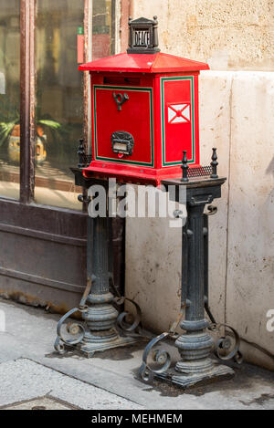 red street mail box in Europe, Budapest, Hungary - Stock Photo