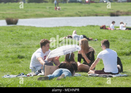 London UK. 22nd April 2018 People enjoying the afternoon  sunshine and warm spring  weather on Wimbledon Common on another glorious hot day in London as temperatures climb to the mid 20's celsius Credit: amer ghazzal/Alamy Live News - Stock Photo