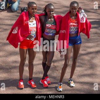 The Mall, London, UK. 22 April 2018. The Virgin Money London Marathon takes place in hot sun with athletes finishing on The Mall. Vivian Cheruiyot (KEN) wins the Elite Women's race, here with Brigid Kosgei (KEN) and Tadelech Bekele (ETH). Credit: Malcolm Park/Alamy Live News. - Stock Photo