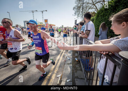 London, UK. 22nd April, 2018. 38th London Marathon passes through Deptford. Credit: Guy Corbishley/Alamy Live News - Stock Photo