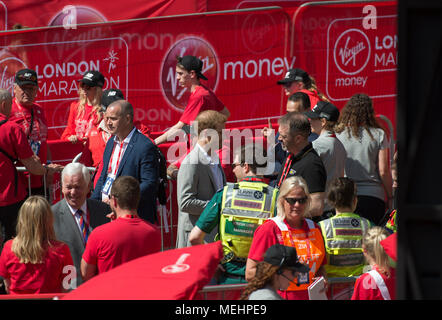 The Mall, London, UK. 22 April 2018. The Virgin Money London Marathon takes place in hot sun with athletes finishing on The Mall. Prince Harry arrives for the medal ceremony. Credit: Malcolm Park/Alamy Live News. - Stock Photo