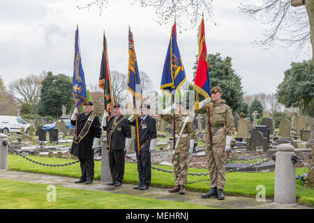 Five Standard Bearers proudly hold their colours during the service to commemorate the anniversary of ANZAC Day - Warrington, UK, 22 April 2018. The Anniversary of ANZAC Day has been commemorated on Sunday 22 April 2018 within Soldiers' Corner of Warrington Cemetery when the Deputy Mayor, Cllr Karen Mundry, Cadets from the Queen's Lancashire Regiment, Warrington Sea Cadets and many veterans were in attendance Credit: John Hopkins/Alamy Live News - Stock Photo