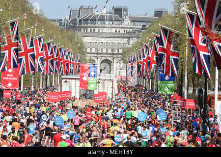 London, UK, 22nd April 2018. Runners finish their race in the crowded Mall. Record numbers of runners are taking part in the famous race - just over 47,000 registered and around 41,000 have picked up their race packs at the start. Despite many struggling with the hot and sunny weather along the route, the race is still expected to be on track to beat previous finish line numbers, too. Credit: Imageplotter News and Sports/Alamy Live News - Stock Photo