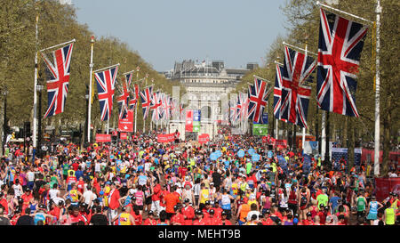 London, UK, 22nd April 2018. Runners crowd into the Mall after finishing the race. Record numbers of runners are taking part in the famous race - just over 47,000 registered and around 41,000 have picked up their race packs at the start. Despite many struggling with the hot and sunny weather along the route, the race is still expected to be on track to beat previous finish line numbers, too. Credit: Imageplotter News and Sports/Alamy Live News - Stock Photo
