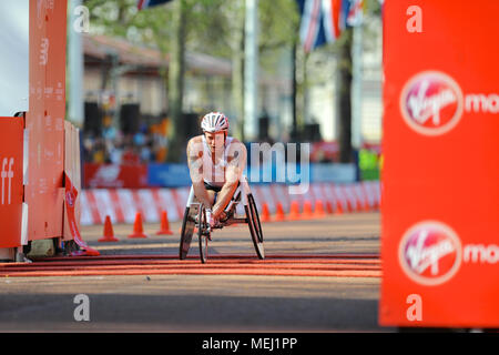 London, UK. 22nd Apr, 2018. Josh Cassidy (CAN) crossing the finish line on The Mall during the Virgin Money London Marathon Men's Wheelchair race, The Mall, London, United Kingdom.  Cassidy finished in 9th place with a time of 01:31:41. Credit: Michael Preston/Alamy Live News - Stock Photo