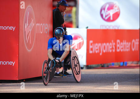 London, UK. 22nd Apr, 2018. Pierre Fairbank (FRA) crossing the finish line on The Mall during the Virgin Money London Marathon Men's Wheelchair race, The Mall, London, United Kingdom.  Fairbank finished in 14th place with a time of 01:33:44. Credit: Michael Preston/Alamy Live News - Stock Photo