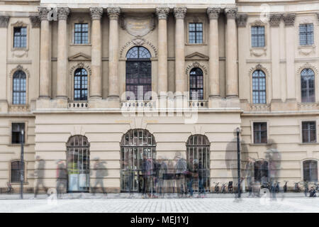 Berlin, Germany. 16th Apr, 2018. Monday, April 16, 2018.Berlin, Germany.A composite image of visitors to the Bebelplatz Memorial, known as the site of one of the infamous Nazi book burning ceremonies, held on May 10, 1933. Members of the Nazi German Student Union and their professors burned approximately 20,000 books as part of a nationwide action 'against the un-German spirit.'.The Bebelplatz memorial was inaugurated in 1995, and it is the work of Israeli artist Micha Ullman. It is a glass plate set in paving stones, and below it there is an underground room with empty bookshelves.A - Stock Photo