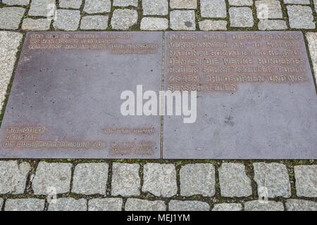 Berlin, Germany. 16th Apr, 2018. Monday, April 16, 2018.Berlin, Germany.A plaque near the Bebelplatz Memorial is engraved with the words, ''Das war ein Vorspiel nur, dort wo man BŸcher verbrennt, verbrennt man am Ende auch Menschen.'' Translated to English: ''That was only a prelude; where they burn books, they will in the end also burn people.'.Bebelplatz is known as the site of one of the infamous Nazi book burning ceremonies, held on May 10, 1933. Members of the Nazi German Student Union and their professors burned approximately 20,000 books as part of a nationwide action 'against th - Stock Photo