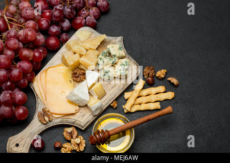 various types of cheese - brie, camembert, roquefort and cheddar - Stock Photo