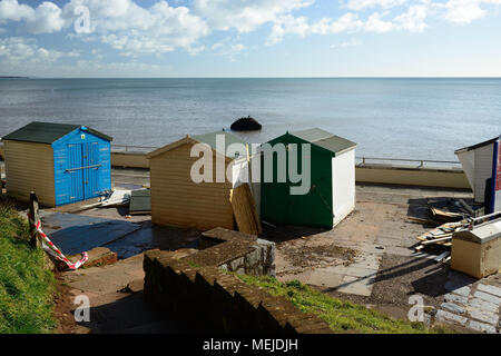 Seafront beach huts wrecked and displaced by stormy weather. - Stock Photo