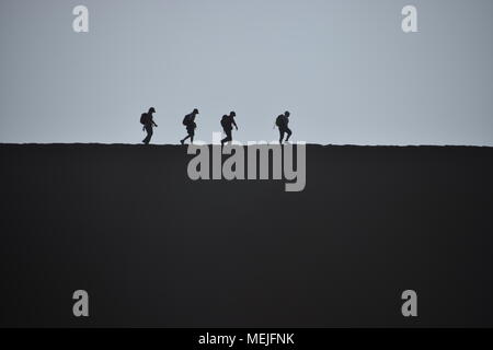 Walking in sand dunes at Sossusvlei - Stock Photo