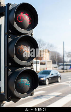 traffic light for a bicycle near a highway in the city - Stock Photo