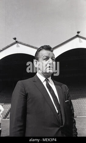 1964, historical picture of Frank Hill, the Scottish manager of Charlton Athletic FC, at their football ground, the Valley. He is wearing the new club tie. A former player for Arsenal in the Herbert Chapman era and nicknamed 'Tiger' Hill, he took Charlton to fourth in the1963–64 season, but was sacked in the summer of 1965. - Stock Photo