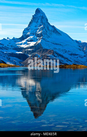 The Matterhorn, Mont Cervin, is reflected in lake Stellisee, Zermatt, Valais, Switzerland - Stock Photo