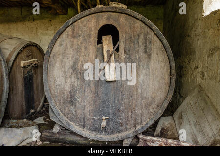 Old abandoned dusty wooden barrel, close up - Stock Photo