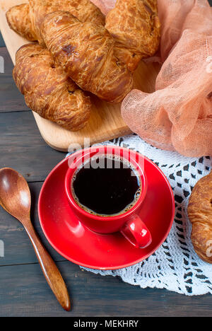 Breakfast with cup of coffee, croissants on dark rustik wooden table, copy space, top view - Stock Photo