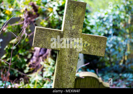 A cross with 'Rest in peace' written on it, Abney Park cemetery, one of the Magnificent Seven cemeteries in London, UK - Stock Photo