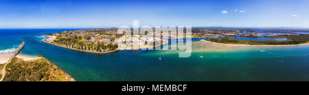 Port Macquarie regional town in NSW, Australia, on Mid North Coast at the river mouth of Hastings river in to Pacific ocean. Aerial wide panorama of t - Stock Photo