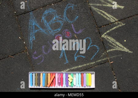 School, ABC and 123 sigh written with colored chalks on a pavement. Drawing Back to school on an asphalt. and vacation concept. Education concept. Sch - Stock Photo