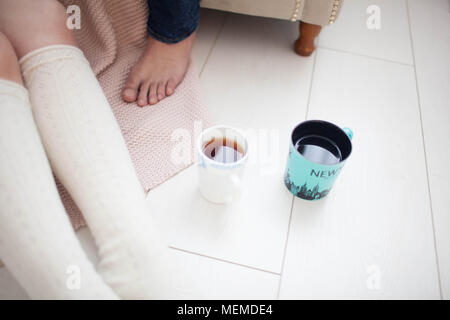 two cups of tea on the floor - Stock Photo