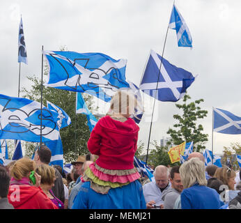 GLASGOW, SCOTLAND -SEPTEMBER 14th 2014: A young girl sitting on her male relative's shoulder during a protest against the BBC. - Stock Photo