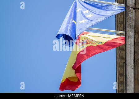Flags of Spain and European Union sticking from vintage building - Stock Photo