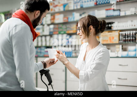 Buying medications in the pharmacy - Stock Photo