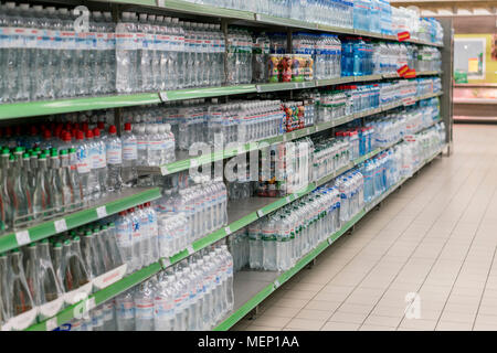 Kiev, Ukraine. February 1 2018. Various choice of plastic mineral water bottles display on the supermarket shelves - Stock Photo