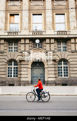 Cycling the old streets of the once East Berlin Germany EU. - Stock Photo