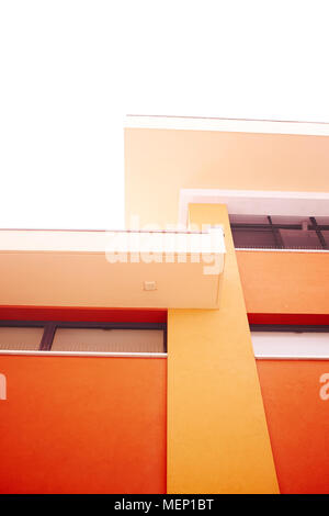 Modern building red orange architectural abstract detail background - Stock Photo