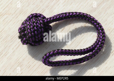 close up of knotted rope dog toy - Stock Photo