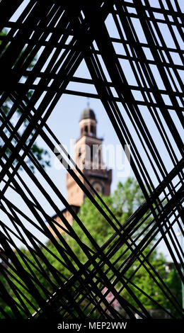 View of the Castello Sforzesco in Milan, Italy on a frame of intelocking cords on the foreground - selective focus on foreground - Stock Photo