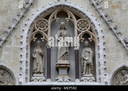 Jesus Christ surrounded by saints Stephen the King and St. Ladislaus, portal of the cathedral in Zagreb, Croatia - Stock Photo